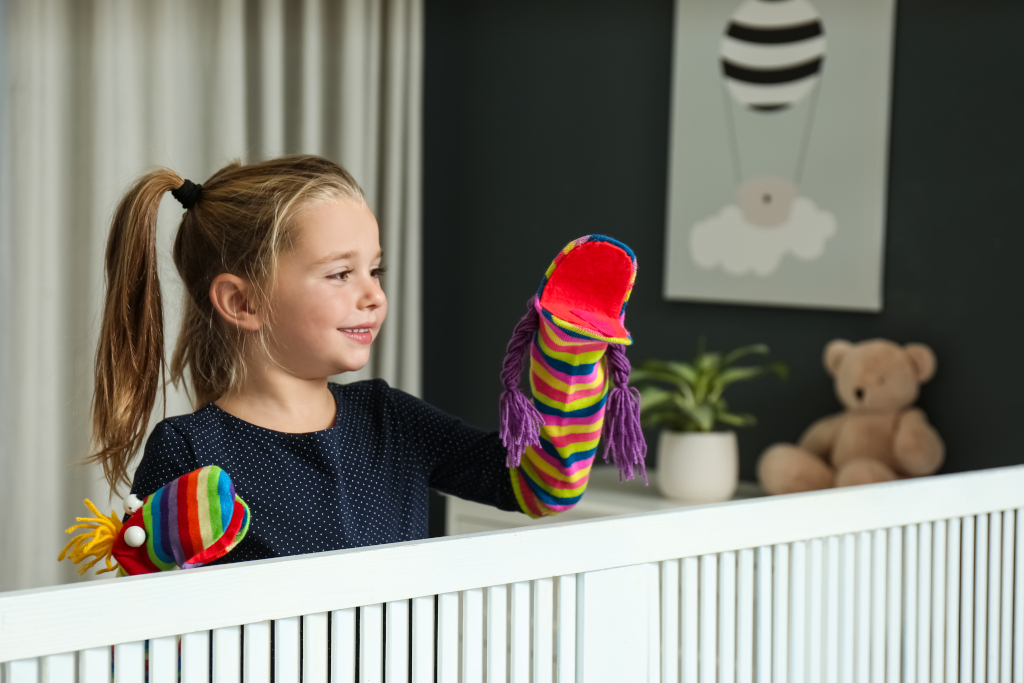 Little Girl Putting On a Puppet Show