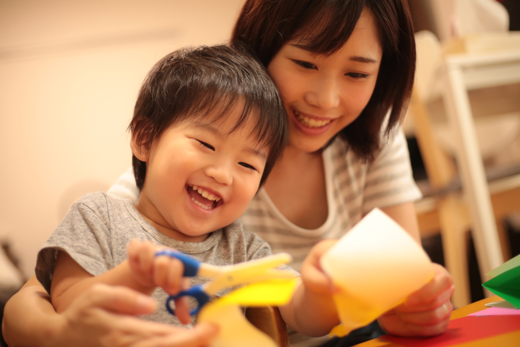 Boy Making Fun Crafts with His Mother
