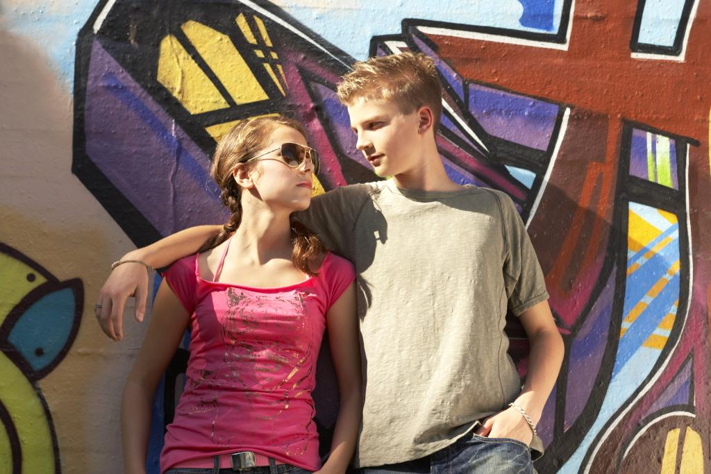 Couple Posing Outdoors on an Art Walk Date